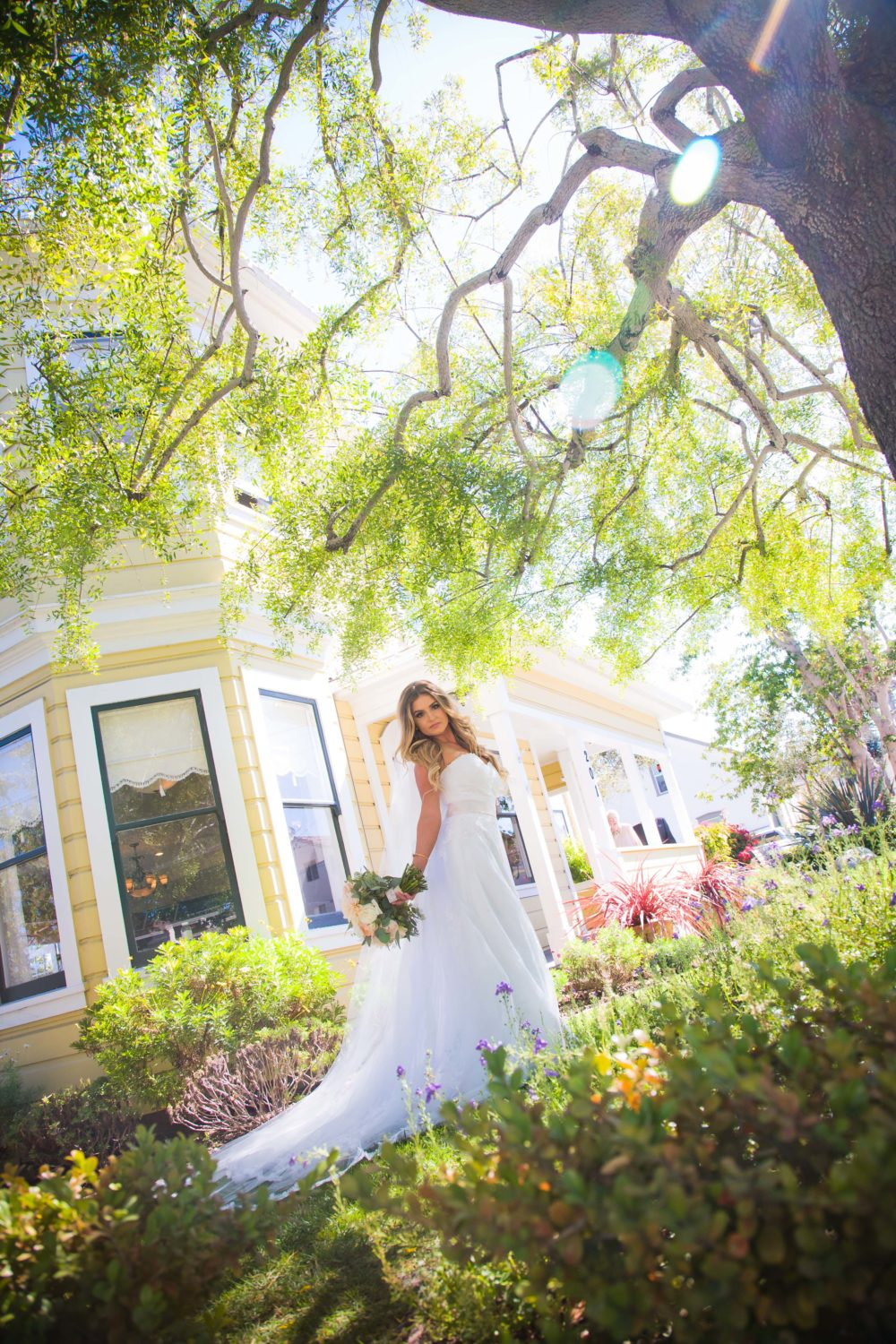 Bride posed in front of The Perry House Monterey Wedding Venue