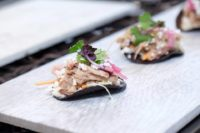 Duck Confit Mini Tostada on Blue Corn Chip