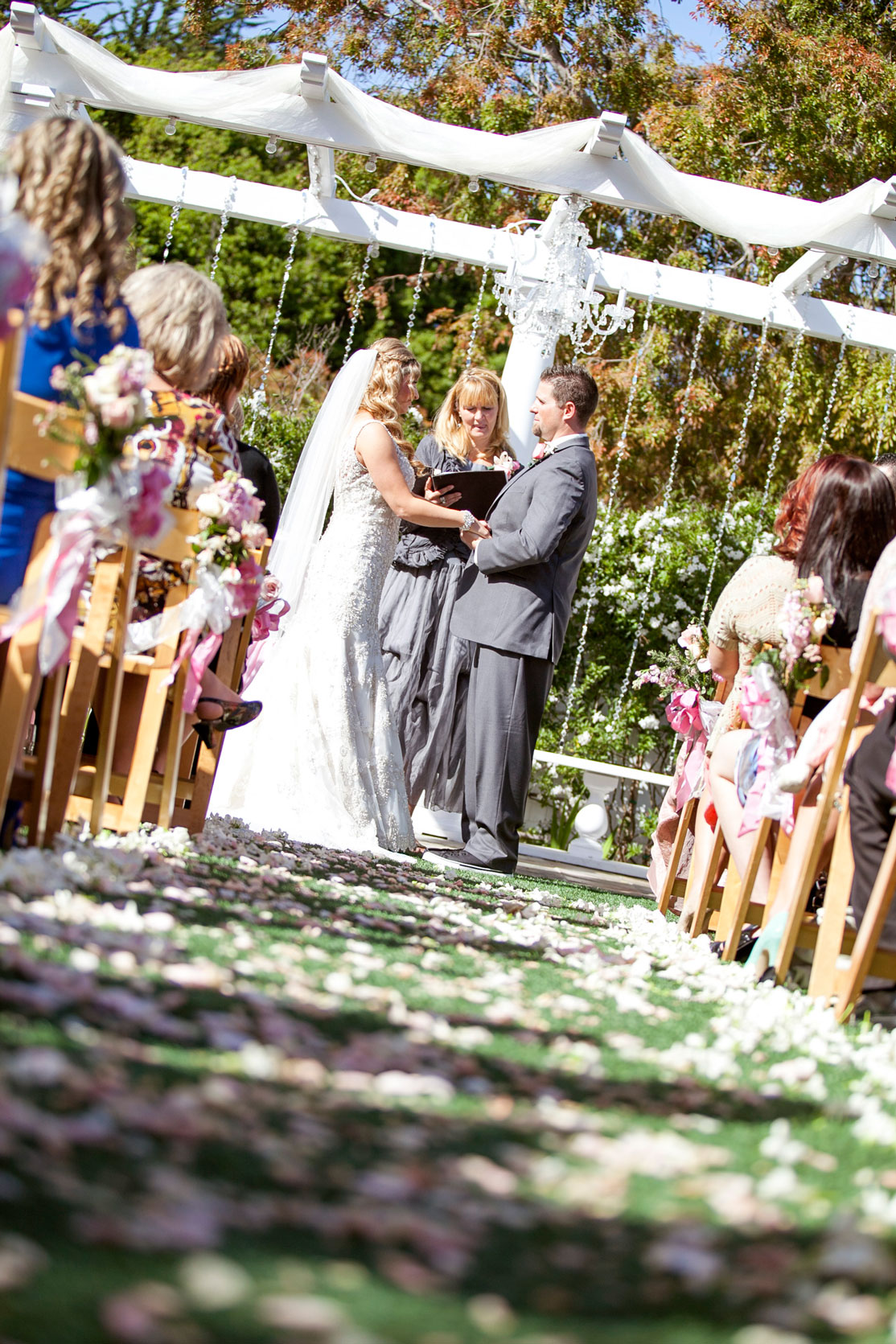 Perry House Ceremony bride and groom pink and white aisle draped arbor with chandelier