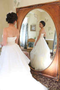 Perry House bride in bridal suite wedding dress in mirror
