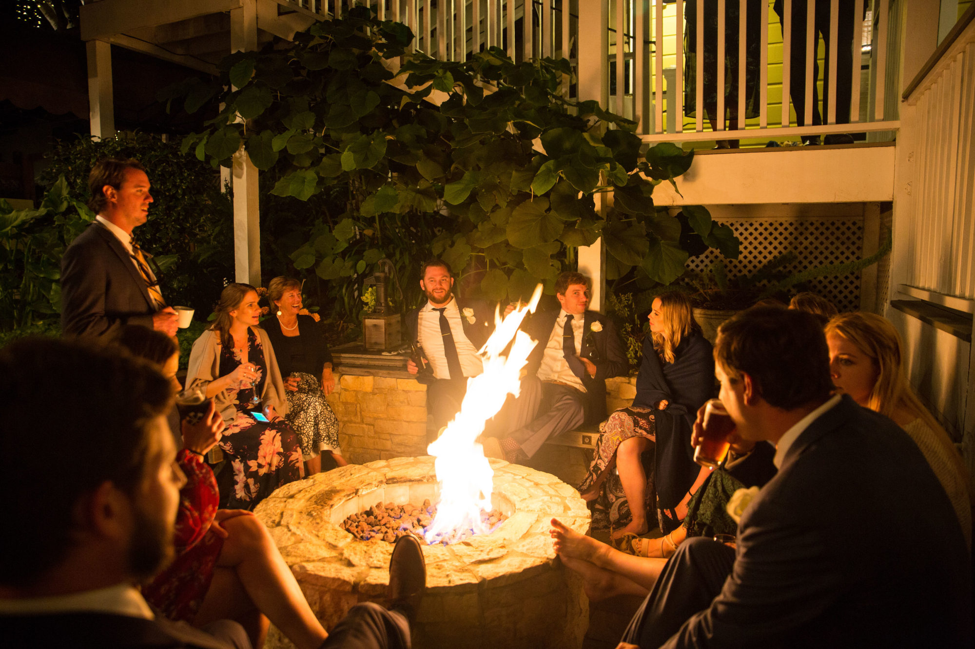 Guests mingling around Perry House Firepit