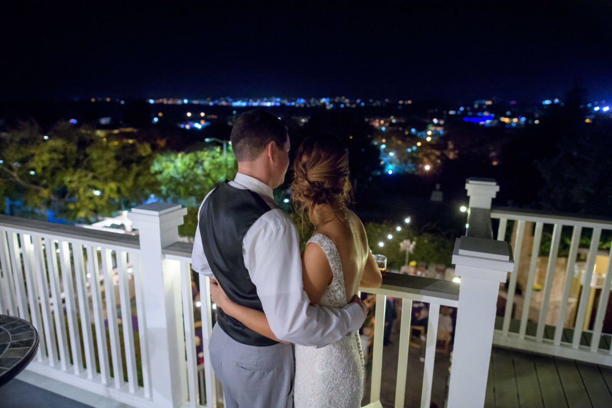Couple looking at City Lights View from Perry House