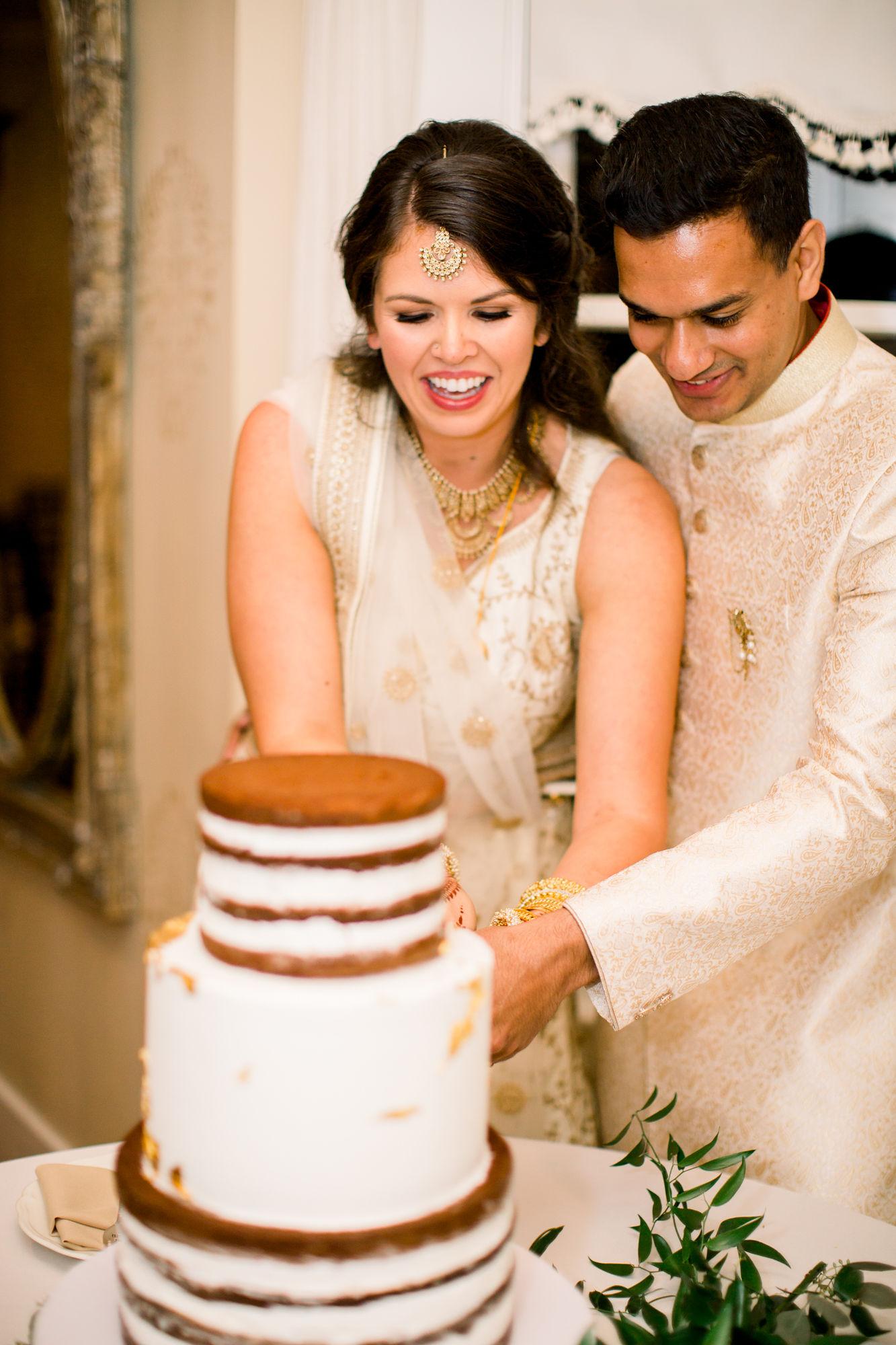 Couple Cutting Cake at Monterey Wedding Venue